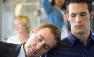 getty_rf_mature_man_with_dandruff_asleep_on_young_mans_shoulder