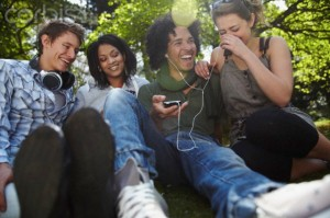 Young friends listening to music together