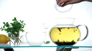 stock-footage-herbal-tea-in-clear-glass-teapot